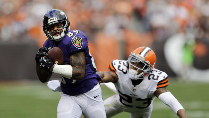 Baltimore Ravens wide receiver Steve Smith (89) catches a pass against Cleveland Browns cornerback Joe Haden in the fourth quarter of an NFL football game Sunday, Sept. 21, 2014, in Cleveland. (AP Photo/Tony Dejak)