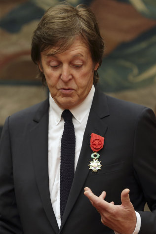 Paul McCartney poses during a decoration ceremony photo session at the Elysee Palace in Paris, Saturday, Sept. 8, 2012. Hollande decorated the former Beatle with a Legion of Honor award, France's highest public distinction which has been awarded to the likes of actor Clint Eastwood and singer Liza Minnelli and Barbara Streisand. (AP Photo/ Philippe Wojazer, Pool)
