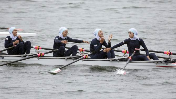 Iran's Homeira Barzegartamrin, Nazanin Malaei, Mahsa Javar, and Soulmaz Abbasiazad react after finishing third in the lightweight womne's quadruple sculls final of the rowing competition at the Chungju Tangeum Lake International  Rowing Center