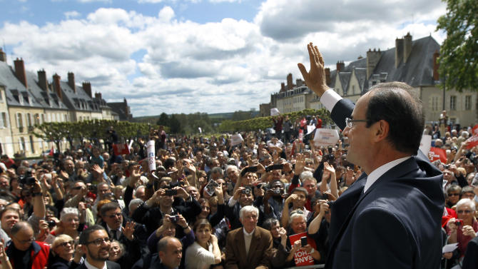 French Socialist Party candidate for the 2012 presidential elections Francois Hollande waves after delivering his speech during a meeting in Nevers, Tuesday, May 1, 2012, as part of his campaign for the second round of the French presidential elections on May 6, 2012. (AP Photo/Christophe Ena)
