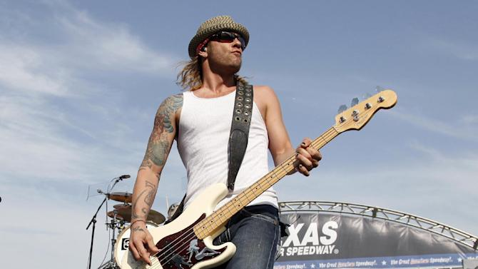 FILE - In this April 9, 2011 file photo, 3 Doors Down' bassist Todd Harrell performs before a NASCAR auto race at Texas Motor Speedway in Fort Worth, Texas. Harrell checked himself into a drug treatment facility after bonding out of jail, the musician's lawyer said Wednesday, April 24, 2013. Harrell is accused of driving under the influence and causing a fatal crash last weekend in a Nashville suburb. Police say the 41-year-old bassist admitted to drinking and taking prescription drugs before the wreck on Friday.  (AP Photo/Tim Sharp, File)