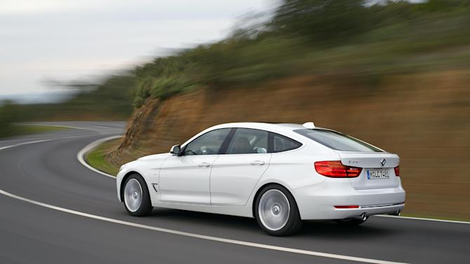 This photo provided by BMW shows the new BMW 3 Series Gran Turismo, one of two important variations of its popular 3-Series small luxury sports sedans. On Wednesday, March 27, 2013, the German automaker will formally unveil the new 3 Series Gran Turismo, which has a bigger distance between the front and rear wheels to create more rear-seat legroom and cargo space in the trunk. The company also will unveil the 328d in the U.S., a 3-Series equipped with a diesel engine that could get more than 40 miles per gallon on the highway. (AP Photo/BMW)