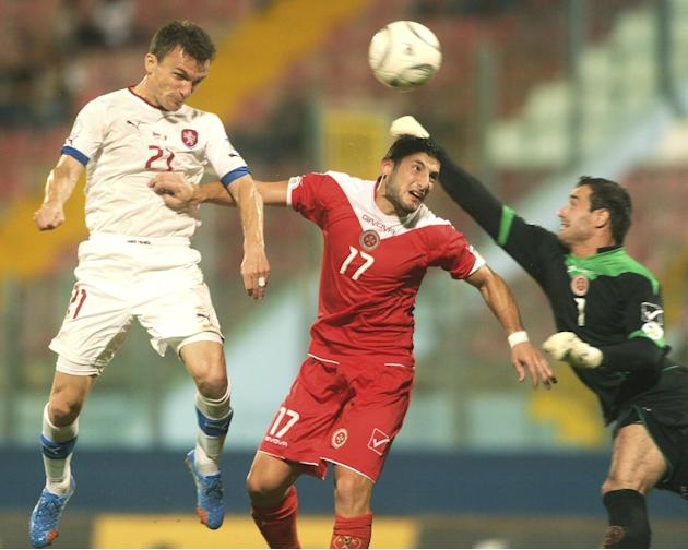 Czech Republic Tom Hbschman, left, scores a goal during the World Cup Group B qualifying soccer match between Malta and Czech Republic at National Stadium Ta' Qali in Valletta, Malta, Friday, Oct. 11,