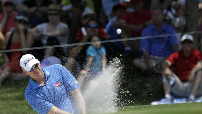 Tom Gillis hits out of a bunker onto the second green during the final round of the Byron Nelson golf tournament on Sunday, May 19, 2013, in Irving, Texas. (AP Photo/Tony Gutierrez)