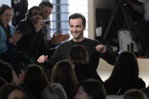 French fashion designer Nicolas Ghesquiere acknowledges…