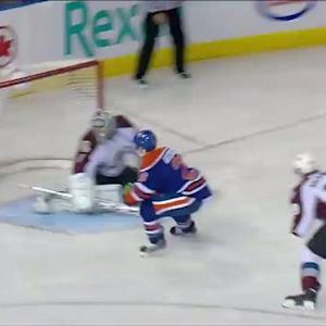 Mark Arcobello scores in front of Varlamov