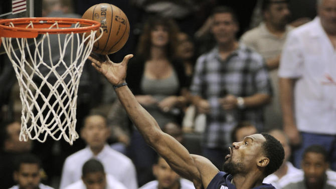 Memphis Grizzlies' Tony Allen scores during the second half of Game 1 of the Western Conference final NBA basketball playoff series against the San Antonio Spurs Sunday, May 19, 2013, in San Antonio. San Antonio won 105-83. (AP Photo/Darren Abate)