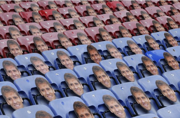 Masks of Aston Villa's former captain Petrov hang from the seats before their English Premier League soccer match against Wigan Athletic in Wigan