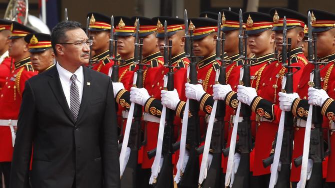 Malaysia's Defence Minister Hishammuddin Hussein and Thailand's Deputy Prime Minister and Defence Minister Prawit Wongsuwan review a guard of honour during Hussein's visit to Thailand, at the Defence Ministry in Bangkok