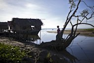 A resident walks in Tanjung Labian, near where Philippine militants have staked a territorial claim on February 21, 2013. The Sultanate of Sulu once controlled parts of Borneo as well as southern Philippine islands