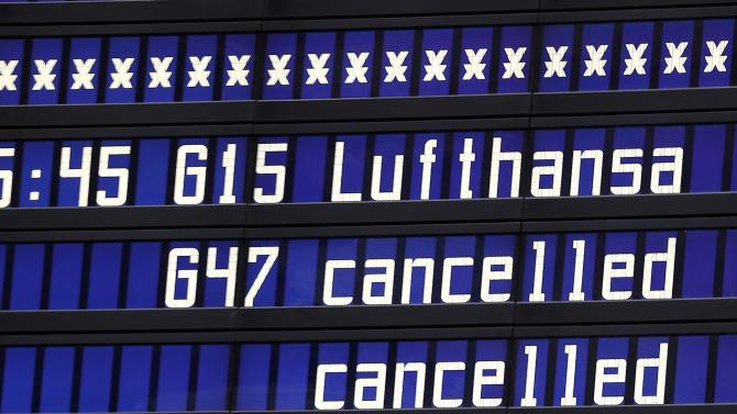 A flight information board displays cancelled flights at Munich airport