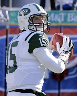 In this Sunday, Dec. 30, 2012 photo, New York Jets quarterback Tim Tebow (15) warms up before an NFL football game against the Buffalo Bills in Orchard Park, N.Y. The New York Jets say, Monday, April 29, 2013, they have waived Tebow. (AP Photo/Gary Wiepert)