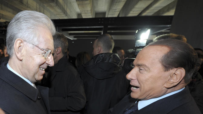 """Italian Premier Mario Monti, left, and former Premier Silvio Berlusconi shake hands in Milan, Italy, Sunday, Jan. 27, 2013. Silvio Berlusconi says Benito Mussolini did much good, except for dictator's regime's anti-Jewish laws. Berlusconi also defended Mussolini for siding with Hitler, saying the late fascist leader likely reasoned that German power would expand so it would be better for Italy to ally itself with Germany. He was speaking to reporters Sunday on the sidelines of a ceremony in Milan to commemorate the Holocaust. When Germany's Nazi regime occupied Italy during World War II, thousands from the tiny Italian Jewish community were deported to death camps. In 1938, before the war's outbreak, Mussolini's regime passed anti-Jewish laws, barring them from universities and many professions, among other bans. Berlusconi called the laws Mussolini's """"worst fault"""" but insisted that in many other things, """"he did good."""" (AP Photo/Antonio Calanni)"""