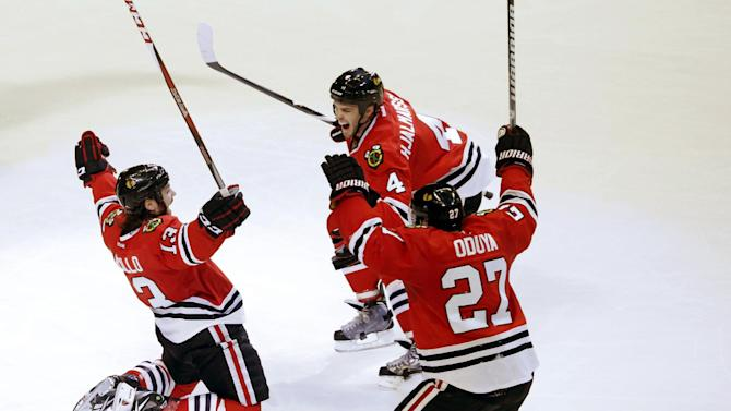 Chicago Blackhawks left wing Daniel Carcillo, left, celebrates his winning goal with Niklas Hjalmarsson (4), of Sweden, and Johnny Oduya (27), also of Sweden, during the third period of an NHL hockey game against the Colorado Avalanche, Wednesday, March 6, 2013, in Chicago. The Blackhawks won 3-2. (AP Photo/Charles Rex Arbogast)