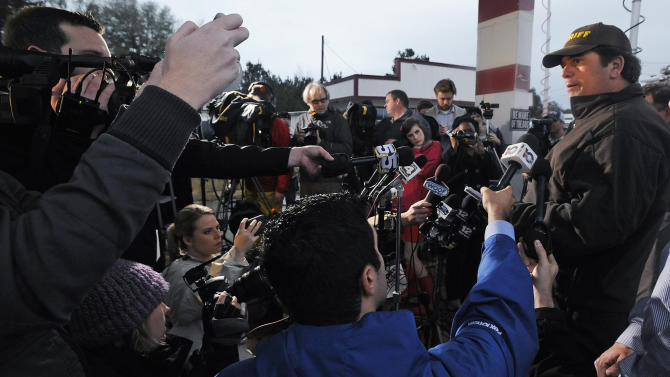 Dale County Sheriff Wally Olsen, right, briefs the media at the Dale County hostage scene in Midland City, Ala. on Wednesday, Jan. 30, 2013. A gunman holed up in a bunker with a 6-year-old hostage kept law officers at bay Wednesday in an all-night, all-day standoff that began when he killed a school bus driver and dragged the boy away, authorities said. (AP Photo/Montgomery Advertiser, Mickey Welsh)