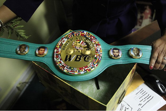 Emanuel Steward's sister Sylvia Steward-Williams holds a championship belt created by the World Boxing Council (WBC) honoring, from left, Emanuel Steward, Muhammad Ali, Joe Louis and Thomas Hearns at