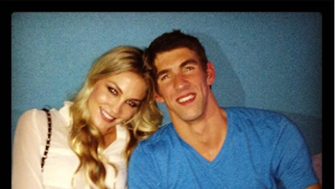 Megan Rossee tweets this image of herself and Michael Phelps with the caption, 'Yay Michael :)' 06.08.12 Supplied by WENN.com  WENN does not claim any ownership including but not limited to Copyright or License in the attached material. Any downloading fees charged by WENN are for WENN's services only, and do not, nor are they intended to, convey to the user any ownership of Copyright or License in the material. By publishing this material you expressly agree to indemnify and to hold WENN and its directors, shareholders and employees harmless from any loss, claims, damages, demands, expenses (including legal fees), or any causes of action or  allegation against WENN arising out of or connected in any way with publication of the material.