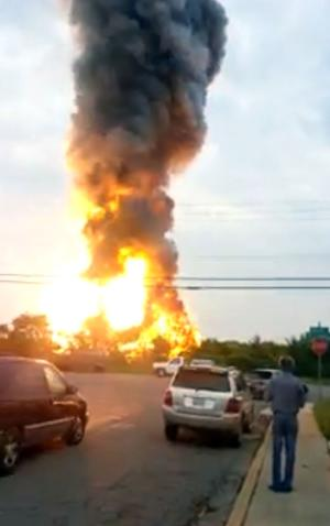 AP10ThingsToSee - This image made from video provided by James LeBrun shows an explosion outside Baltimore on Tuesday, May, 28, 2013 after a train derailed in White Marsh, Md. (AP Photo/James LeBrun)
