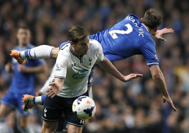Chelsea's Ivanovic is challenged by Tottenham Hotspur's Vertonghen during their English Premier League soccer match at Stamford Bridge in London
