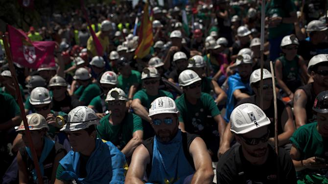 Coal miners arrive near Spain Industry Ministry after marching up Madrid's main north-south avenue on Wednesday July 11, 2012.  Riot police fired rubber bullets Wednesday at Spanish coal miners protesting in the streets of Madrid over subsidy cuts they fear will jeopardize their meager livelihood. The miners' march into the capital was the culmination for some of a nearly three-week trek from the regions where they eke out a living.  (AP Photo/Emilio Morenatti)