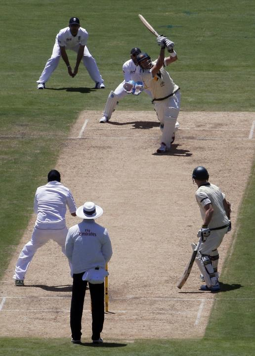 Australia's Watson hits a six from the bowling of England's Panesar during the first day's play in the second Ashes test in Adelaide