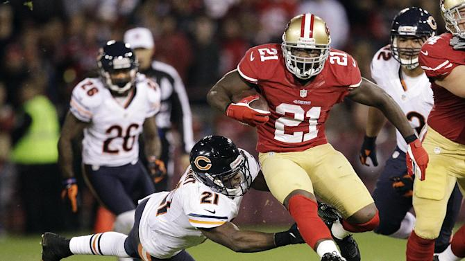 San Francisco 49ers running back Frank Gore (21) leaps past Chicago Bears strong safety Major Wright (21) during the second quarter of an NFL football game in San Francisco, Monday, Nov. 19, 2012. (AP Photo/Tony Avelar)