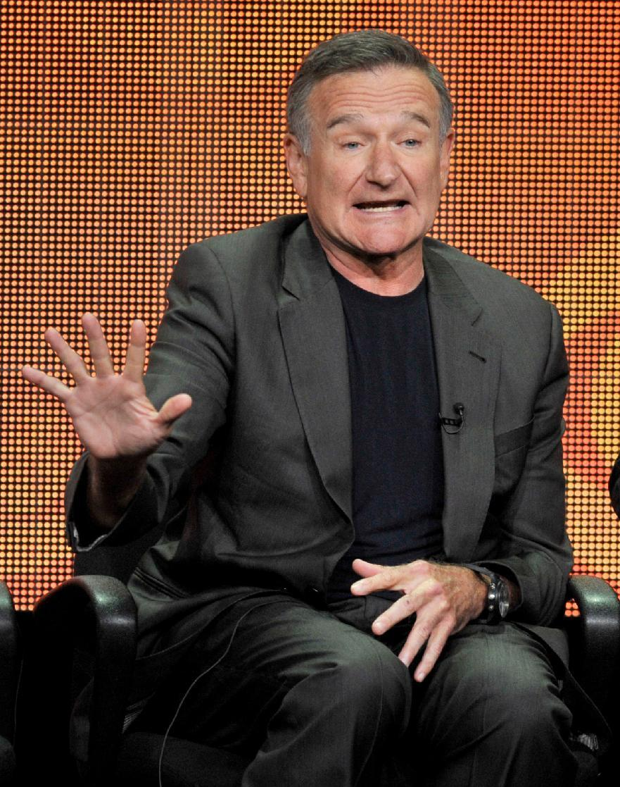 "FILE - This July 29, 2013 file photo shows Robin Williams participating in ""The Crazy Ones"" panel at the CBS Summer TCA in Beverly Hills, Calif. (Photo by Chris Pizzello/Invision/AP, File)"