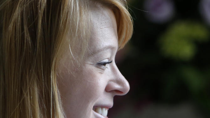 Adrianne Haslet, a a professional ballroom dancer injured by one of the bombs that exploded near the Boston Marathon finish line, smiles in her room at Spaulding Rehabilitation Hospital in Boston, Wednesday, April 24, 2013.  Haslet, who lost her left foot and part of her lower leg, vows that she will dance again.  (AP Photo/Bizuayehu Tesfaye)