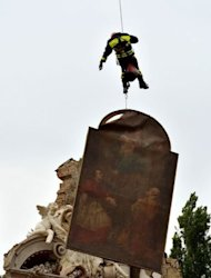 Firemen recover a painting from a destroyed church in the village of San Carlo after an earthquake, in the Modena province, on May 20. In villages and towns across the flatlands of the Emilia Romagna region most of the modern two-storey homes remained intact while Art Nouveau villas, rustic farmhouses and churches were brought down by the 5.9-magnitude quake