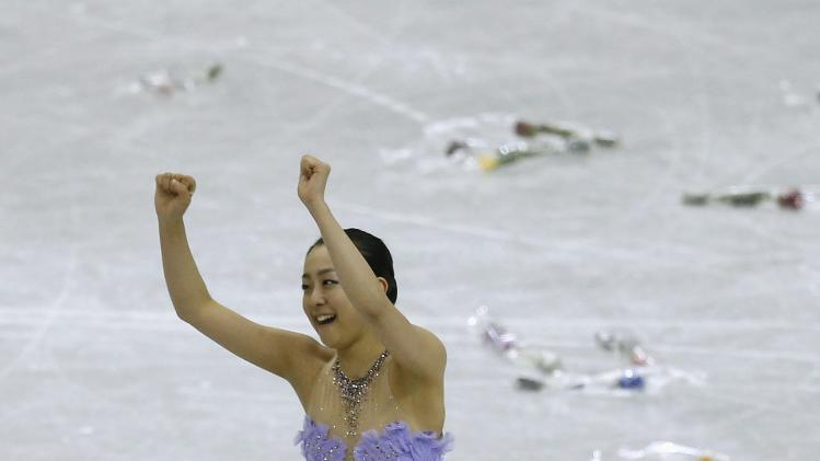 Asada of Japan reacts after performing during the women's short programme at the ISU Grand Prix of Figure Skating Final in Fukuoka