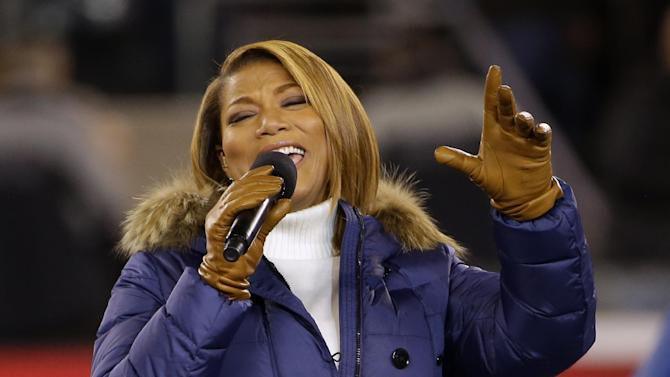 """Queen Latifah sings """"America the Beautiful"""" before the NFL Super Bowl XLVIII football game between the Seattle Seahawks and the Denver Broncos Sunday, Feb. 2, 2014, in East Rutherford, N.J. (AP Photo/Matt Slocum)"""