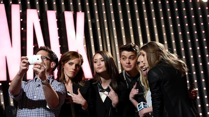 """IMAGE DISTRIBUTED FOR MTV - MTV News correspondent Josh Horowitz, from left, and cast members of """"The Bling Ring"""", Emma Watson, Katie Chang, Israel Broussard, Claire Julien and Taissa Farmiga are seen at """"The MTV Movie Awards Sneak Peek Week"""" on Friday, April 12, 2013 in Universal City, Calif. (Photo by Matt Sayles/Invision for MTV/AP Images)"""