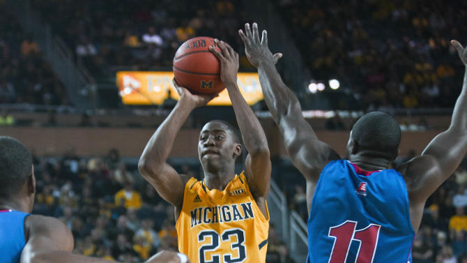 Michigan raises banner, beats UMass-Lowell 69-42