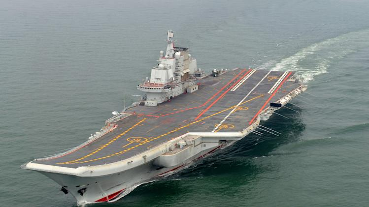 FILE - In this May 2012 file photo provided by China's Xinhua News Agency, Chinese aircraft carrier Liaoning cruises for a test on the sea. China has begun flight training on its first aircraft carrier, with photographs posted on websites Monday, Oct. 15, 2012. Global military spending dipped last year for the first time since 1998 as defense outlays shrunk in the West but rose in Russia, China and the Middle East, a Swedish-based arms watchdog said Monday April 15, 2013. The Stockholm International Peace Research Institute said the world spent $1.75 trillion on its armed forces in 2012, down 0.5 percent from the year before. (AP Photo/Xinhua, Li Tang, File) NO SALES