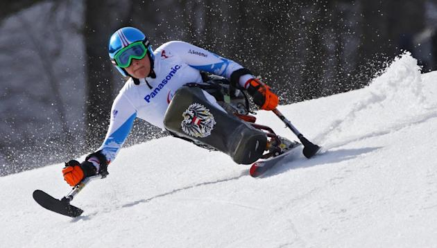 Claudia Loesch of Austria races to win silver medal in the alpine skiing, ladies, Super-G, sitting event at the 2014 Winter Paralympics, Monday, March 10, 2014, in Krasnaya Polyana, Russia