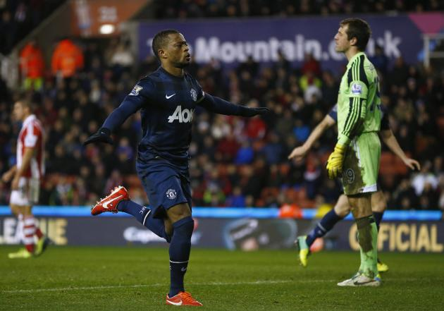 Manchester United's Evra celebrates scoring during their English League Cup quarter-final soccer match against Stoke City at the Britannia stadium in Stoke-on-Trent