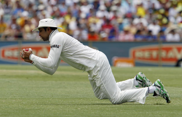 India's VVS Laxman catches Australia's Shaun Marsh on the second day of their cricket test match at the WACA in Perth, Australia, Saturday, Jan. 14, 2012. India made 161 in their first innings