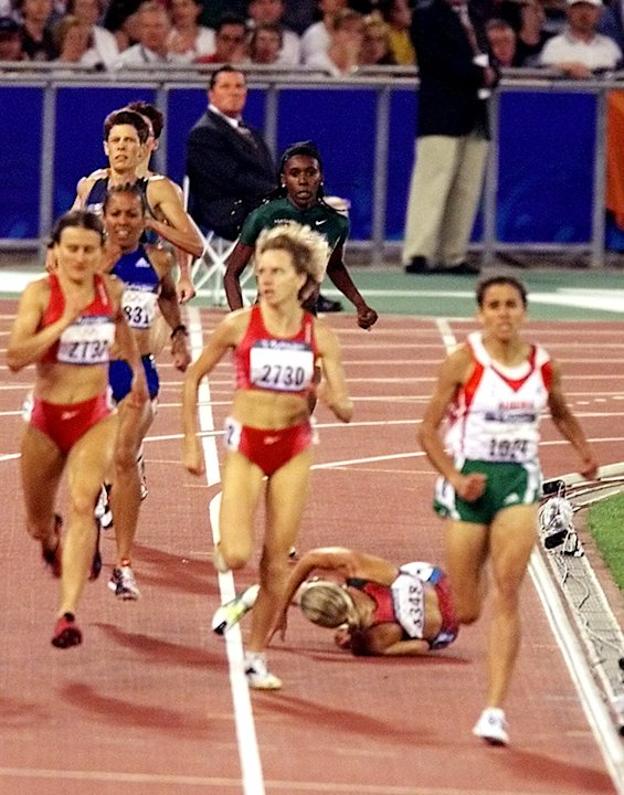 U.S. runner Suzy Favor Hamilton falls during the women's 1,500 meter final at the Summer Olympics Saturday, Sept. 30, 2000, at Olympic Stadium in Sydney. Gold medal winner Nouria Merah-Benida of Alger