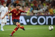 Spanish midfielder Xabi Alonso shoots to score a penalty during the Euro 2012 football championships quarter-final match Spain vs France on June 23, 2012 at the Donbass Arena in Donetsk.   AFP PHOTO / FRANCK FIFE