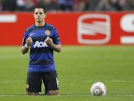 Manchester United player Javier Hernandez kneels before kick off during a UEFA Cup League match on February 16. Hernandez will not play for Mexico at this summer's London Olympics, his club announced on Thursday. Hernandez, who turns 24 on June 1, had initially been called up as one of Mexico's three over-age players, but United have now agreed with the Mexican FA he will have the full summer off