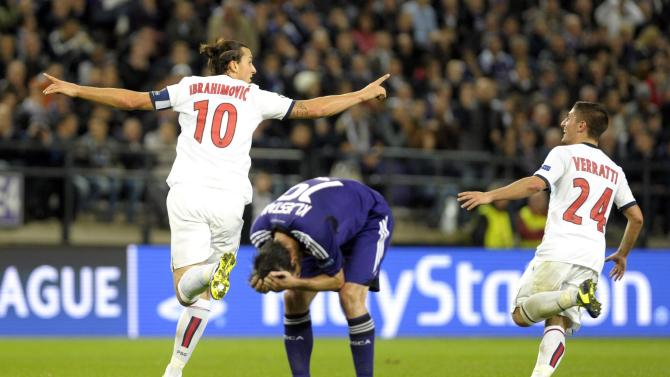 Paris Saint-Germain's Ibrahimovic react with Verratti after scoring hattrick against Anderlecht during their Champions League soccer match at Constant Vanden Stock stadium in Brussels