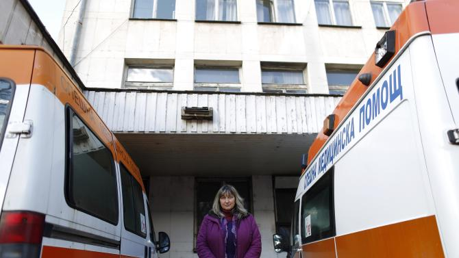 Bulgarian doctor Marinova poses for a picture near ambulances at a hospital in the town of Botevgrad