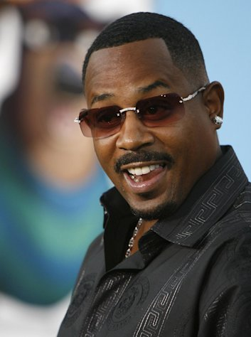 "FILE - In a Monday, Sept. 25, 2006 file photo, actor Martin Lawrence poses for photographers at the premiere of ""Open Season"" in Los Angeles. Court records show Lawrence filed for divorce from Shamicka Lawrence on Wednesday, April 25, 2012, in Los Angeles, citing irreconcilable differences. The couple were married in July 2010 and have two daughters, ages 9 and 11, together. (AP Photo/Matt Sayles, File)"