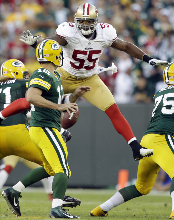 San Francisco 49ers' Ahmad Brooks (55) leaps up to sack Green Bay Packers quarterback Aaron Rodgers (12) during the second half of an NFL football game Sunday, Sept. 9, 2012, in Green Bay, Wis. The 49