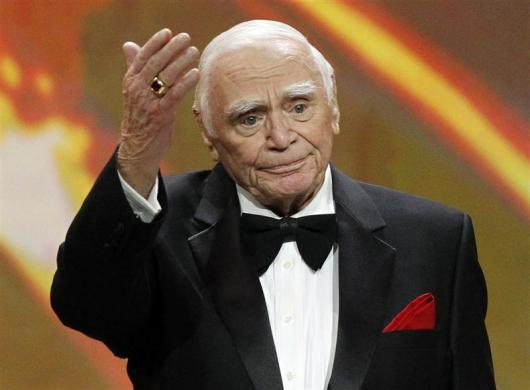 Lifetime achievement honoree Ernest Borgnine waves after receiving his award at the 17th annual Screen Actors Guild Awards in Los Angeles