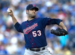 Blackburn helps Twins top Royals 4-2
