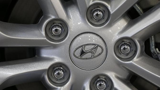 In this Friday, Jan. 18, 2013 photo, shown is a Hyundai emblem at the Philadelphia Auto Show in Philadelphia. South Korea's largest automaker said Thursday Jan. 23, 2013 it earned 1.89 trillion won ($1.77 billion) in the October-December quarter, down 5.5 percent over a year earlier.  (AP Photo/Matt Rourke)
