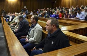 "Members of the right-wing ""Boeremag"" wait ahead of their sentencing at Pretoria High Court"