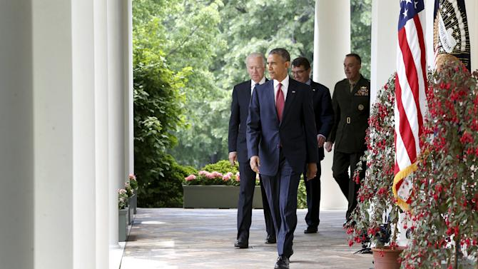 Obama walks out with Biden and Carter to introduce Dunford as his nominee to be the next chairman of the Joint Chiefs of Staff, in the Rose Garden at the White House in Washington