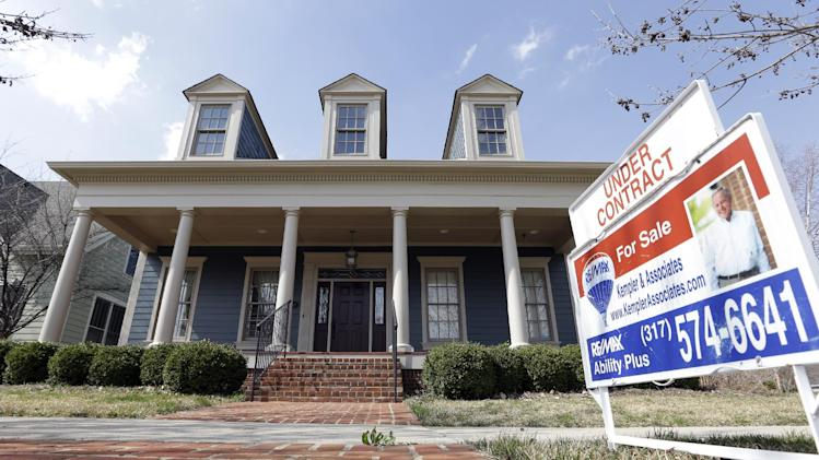 "In this Tuesday, April 9, 2013 photo, an ""Under Contract"" sign is posted outside a home in Carmel, Ind. U.S. home prices soared 12.1 percent in April from a year earlier, the biggest gain since February 2006, as more buyers competed for fewer homes, real estate data provider CoreLogic reports, Tuesday, June 4, 2013. (AP Photo/Michael Conroy)"
